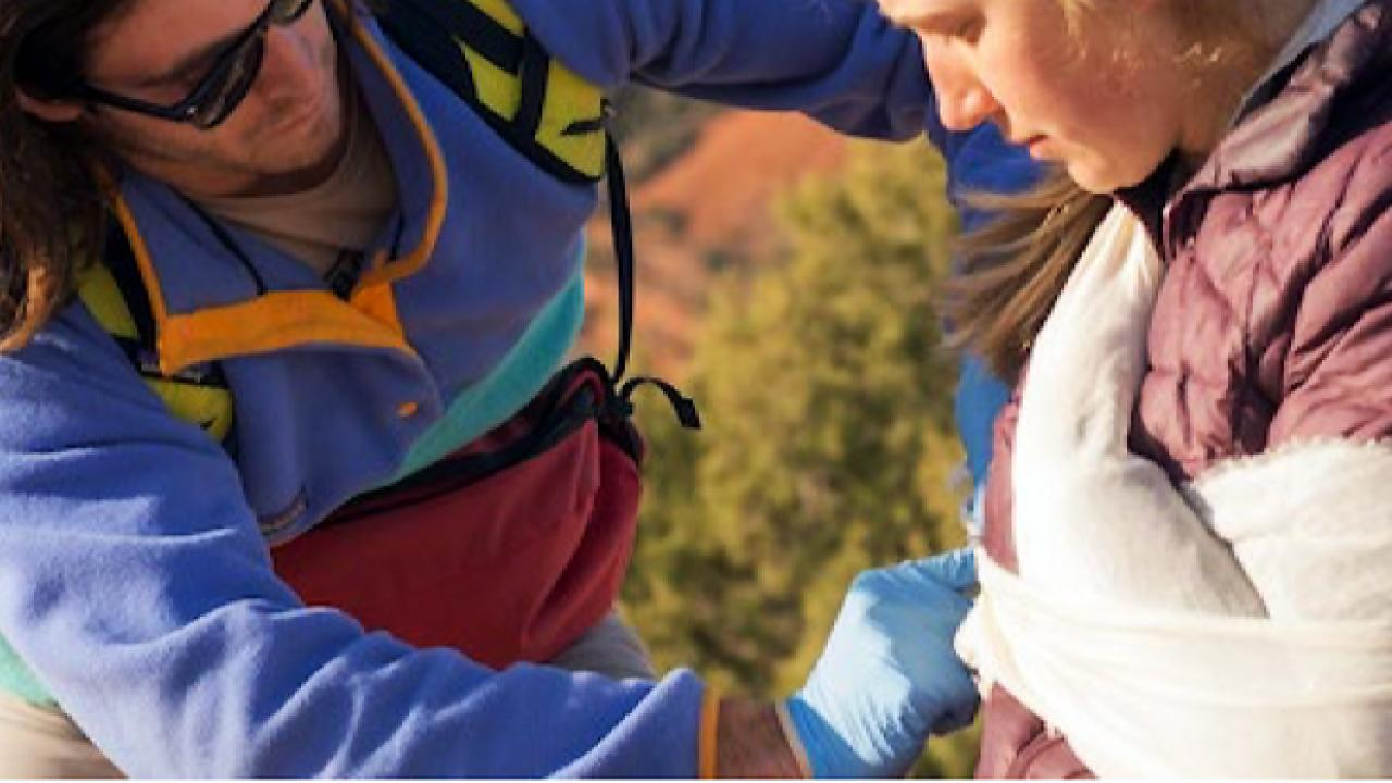 Photo of medic treating injury.