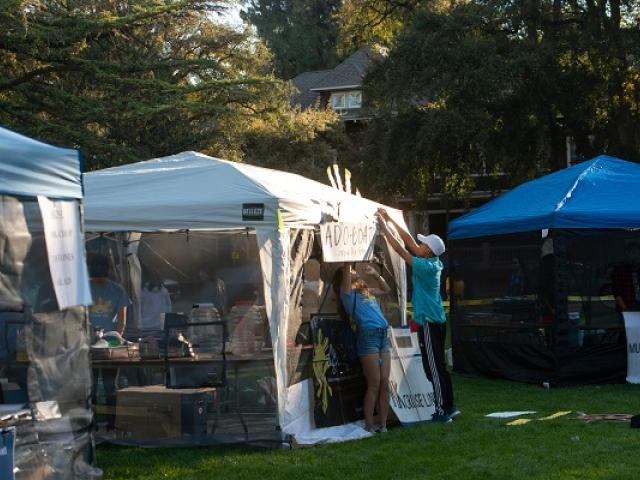 students setting up food booth on UC Davis quad.
